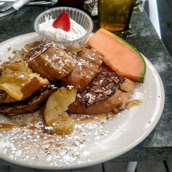 GF French Toast with pears, walnuts, caramel drizzle, and home-made whipped cream... simply amazing!