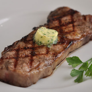 Grilled New York Strip with Herb Garlic Butter