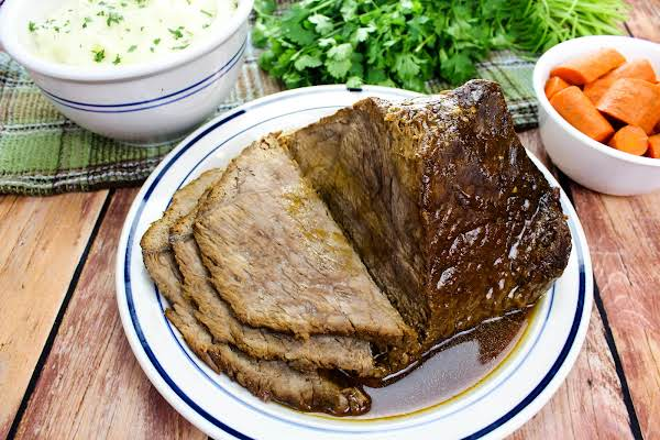 Easiest Pressure Cooker Pot Roast And Gravy Sliced On A Plate.