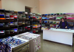 Photo: I found a fabric store with almost all solid material and very little cotton.