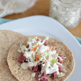 Corned Beef and Cabbage Tacos with Guinness Horseradish Cream Sauce.