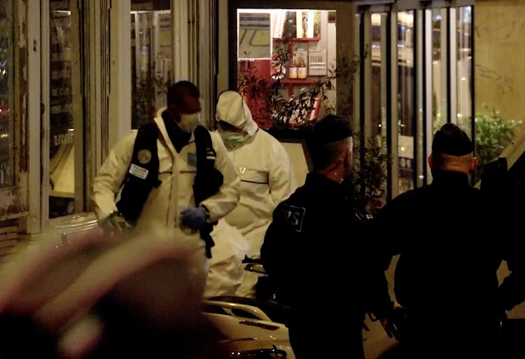 French officials inspect the scene of a knife attack in Paris, France, May 12 2018. Picture: REUTERS/TV