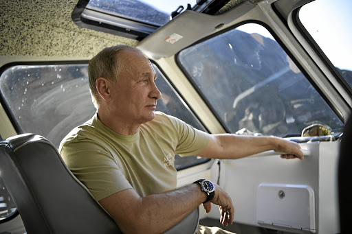 In the driving seat: The Kremlin has rejected UK allegations that Russia President Vladimir Putin is behind the attack in Salisbury near London in March. Britain is urging the increase of sanctions. Picture: REUTERS