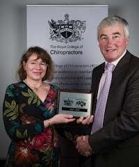Lara Cawthra receiving an award from the royal college of chiropractors
