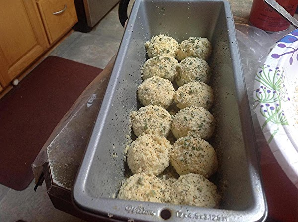 Repeat until all the dinner rolls have been coated with the Parmesan mixture. Spray...