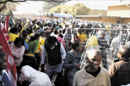 CURIOUS MASS: A large number of soccer fans crowded into the Vaal University of Technology to view the Fifa World Cup trophy when it arrived in the area yesterday. Five people were injured as the crowd jostled to see the prized object. Pic: LEN KUMALO. 03/06/2010. © Sowetan.