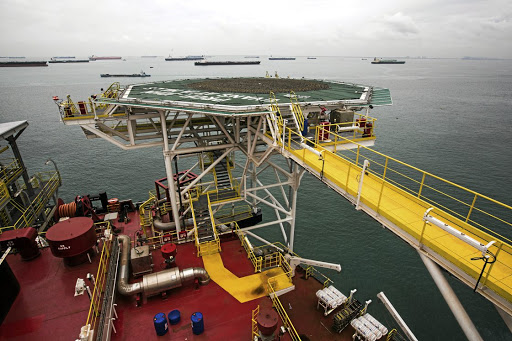 Oil tankers are seen beyond Tullow Oil's production storage and offloading (FPSO) vessel off Western Ghana.