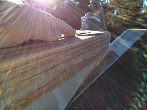 Photo: sanding the repair along the starboard bow