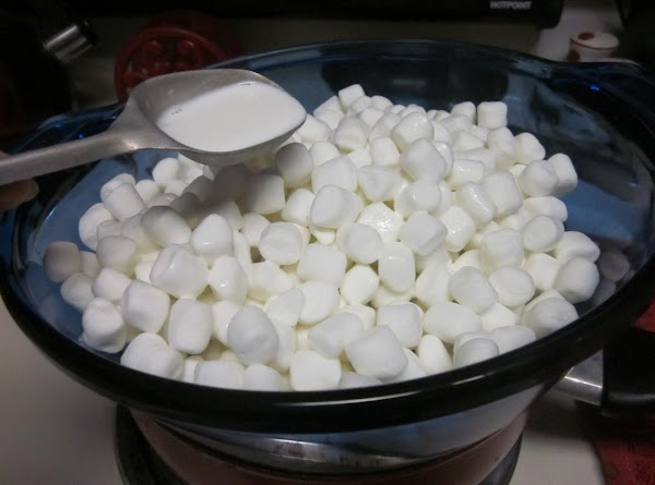 Place the marshmallows and 3 Tablespoons of the Half and Half in the top...