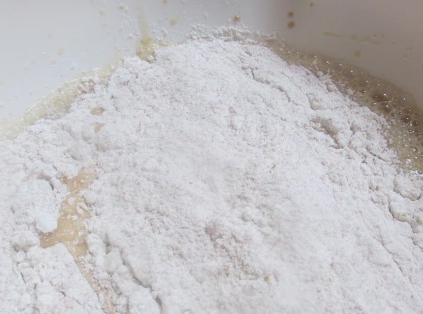 Add about half of flour and beat till blended.