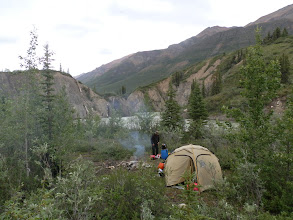 Photo: Camp 7/13 – Upper canyon. Easy to see the approach to canyon, keep/land left. We walked & checked the whole canyon. Had a camp & paddled next morning through. There is a place to land after every bend, five bends. Every bend has also large wawes, which can be avoided by careful steering & staying inside on the left hand bends. No speed needed, just go with the water. Latitude: 64.562599° N Longitude: 132.231445° W