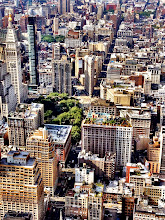 """Photo: """"Lego...""""  From above, the Flatiron Building (in the middle of this photo) looks like a tiny little lego piece: one piece in a set of thousands that make up all the toy buildings in midtown Manhattan.  Still going through the hundreds of photos I took a few weeks back from the top of the Empire State Building. It was such a beautiful day and the sun created the most beautiful shadows that lined the streets below. Hopefully, in a few weeks I will start posting my regular photography from that day but for now here is a phone photo. :)    New York Photography: The New York City skyline in midtown Manhattan including the Flatiron Building.    This photo was taken and edited with my phone using Camera+. I am @newyorklens on Instagram (view my feed here: http://goo.gl/8hbcE ). You can check out some of my mobile photography on Flickr here: http://goo.gl/BxNpG .    View this post if you wish at my site here:  http://nythroughthelens.com/post/32681739999/the-new-york-city-skyline-and-the-flatiron    Tags: #photography  #nyc  #newyorkcity  #newyorkcityphotography  #city  #cityscape  #urban  #mobilephotography  #mobilemonday  #iphoneography  #iphonography  #flatironbuilding"""