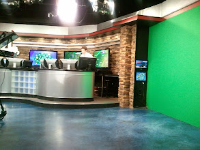 Photo: Dan Thomas at the weather desk.