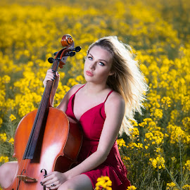 Cello in field by Chris O'Brien - People Portraits of Women ( field, red, woman, yello, beauty, portrait )