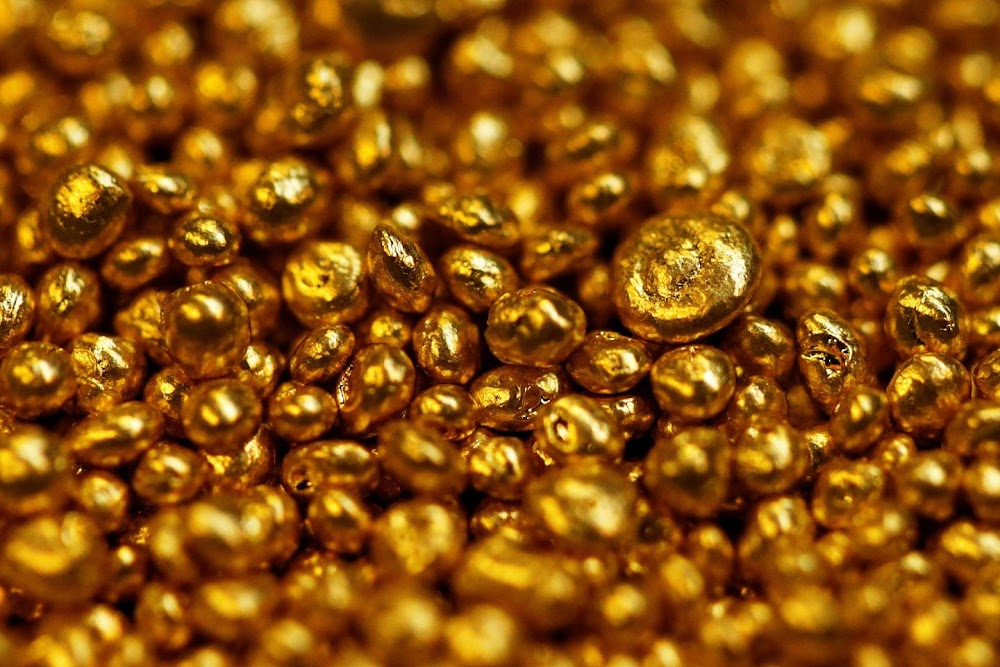 Gold rises amid a lack of clear signs on trade war