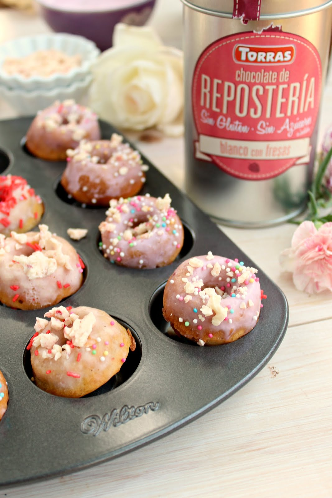 Skinny Strawberry White Chocolate Glazed Donuts - high in protein and low in sugar!
