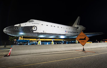 Photo: The space shuttle Endeavour is seen atop the Over Land Transporter (OLT) after exiting the Los Angeles International Airport on its way to its new home at the California Science Center in Los Angeles, Friday, Oct. 12, 2012.  Endeavour, built as a replacement for space shuttle Challenger, completed 25 missions, spent 299 days in orbit, and orbited Earth 4,671 times while traveling 122,883,151 miles. Beginning Oct. 30, the shuttle will be on display in the CSC's Samuel Oschin Space Shuttle Endeavour Display Pavilion, embarking on its new mission to commemorate past achievements in space and educate and inspire future generations of explorers. Photo Credit: (NASA/Bill Ingalls)