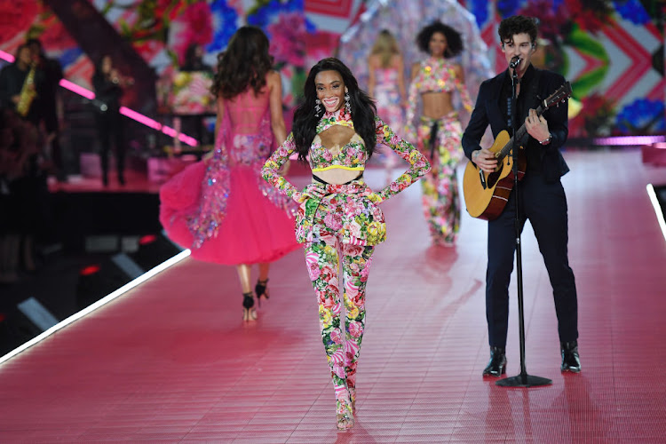 Winnie Harlow walks the runway as Shawn Mendes performs during the 2018 Victoria's Secret Fashion Show on November 8 in New York City.
