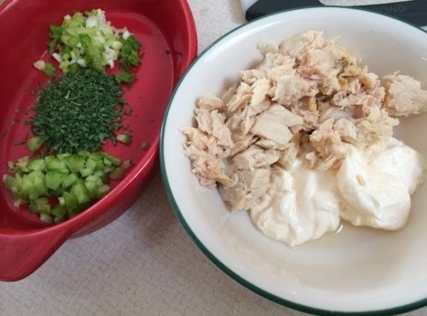 Pre heat oven to broil. Combine 4 tablespoons mayonnaise, tuna, celery, scallions, parsley, and...