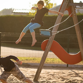 by Eden Meyer - People Family ( park, jumping, children, sister and brother,  )