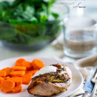 Spinach & Artichoke Stuffed Chicken Breast with Greek Yogurt Sauce.