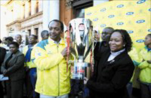 THE PARADE: Mamaledi Sundowns boss Patrice Motsepe, left, with Tshwane Mayor Dr Gwen Ramokgopa during the side's victory parade throught the streets of Pretoria yesterday. Pic. Kopano Tlape.