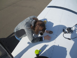 Photo: Susan Bell, pilot, checking the fuel!