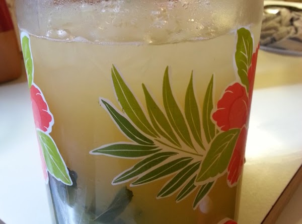 In a large pitcher, combine the mint syrup, lemon juice, orange juice, and ginger...