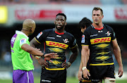 The DHL Stormers captain Siya Kolisi (C) has a chat with match referee Egon Seconds during a Super Rugby match against the Emirates Lions at Newlands in Cape Town on February 23 2019.