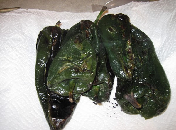 Blister & peel the peppers.  I turn on the broiler, place the peppers...