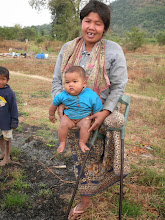 Photo: Cham Sa Ngem and son - mother of 3 children, homeless - house provided by Canadian Landmine Foundation