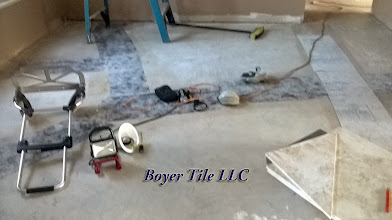 Photo: Image shows crack suppress material laid over properly prepared cement. If this were a thinset installation, leveling compound would be poured over the material later to level the floor, if it were not level at that point.