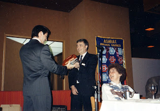 Photo: Past President Neil Armstrong (right) receives the Red Phone Communication Award for Region II, from Chapter President Ross McIntyre