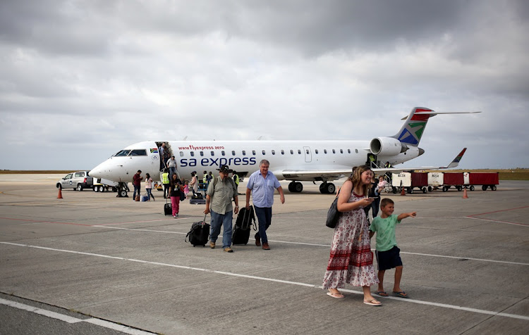 Passengers alight from an SA Express plane. File Photo.