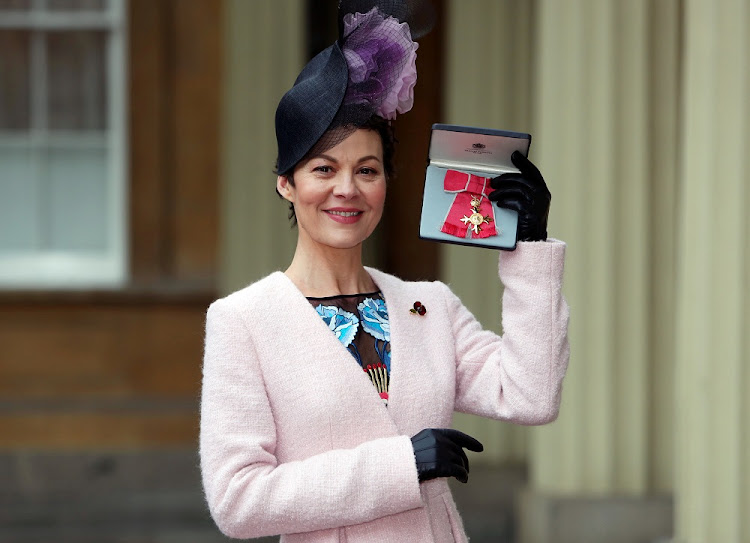 Helen McCrory poses after she was awarded an OBE by Britain's Queen Elizabeth at an Investiture ceremony at Buckingham Palace, London. She succumbed to cancer at 52.