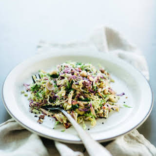 Brussels Sprouts, Honeycrisp & Cabbage Slaw w/ Spicy Almond Butter Sauce | v & gf.