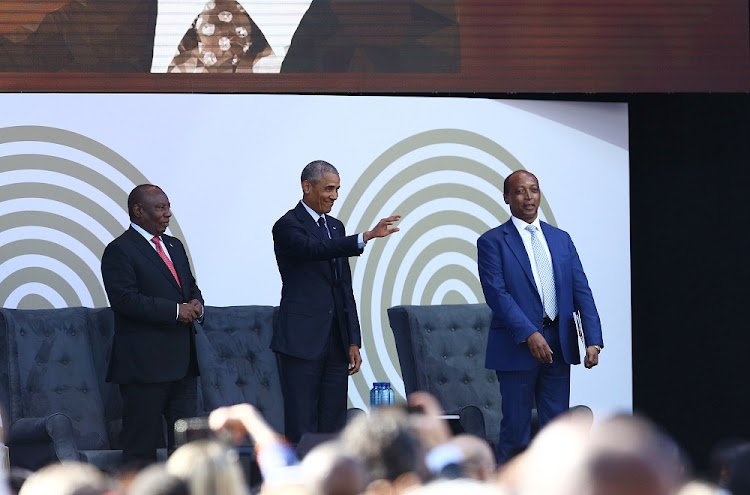 Former US President Barack Obama, centre, flanked by President Cyril Ramaphosa, left, and Patrice Motsepe greets those in attendance at the 16th Nelson Mandela Annual Lecture at Wanderers Stadium on July 17 2018. Picture: MASI LOSI