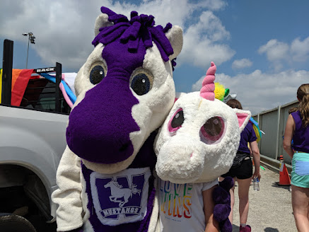 JW and a new unicorn buddy at the Pride parade in 2019