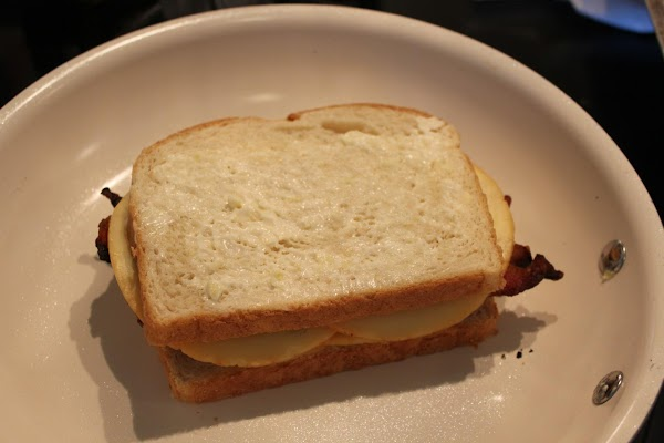 Put sandwich in a preheated skillet and grill with the grilled cheese garlic mayo...
