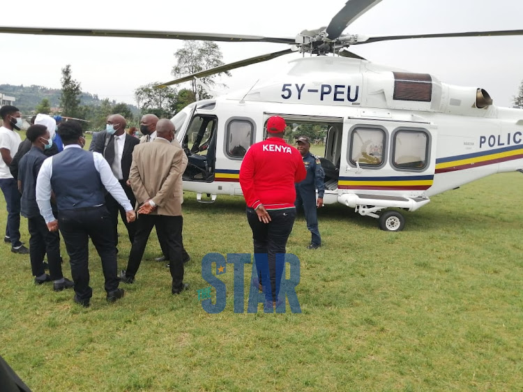 The police chopper carrying Simon Nyachae's body lands at Kisii School./ANGWENYI GICHANA