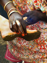 Photo: first, henna paste is applied to the soles of the feet