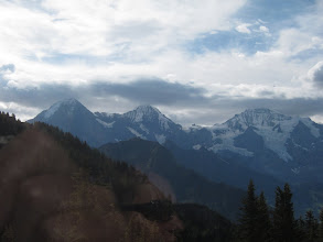 Photo: Through the train window we get our first glimpse of the world's most famous mountain trio: the Eiger, the Monch, and the Jungfrau