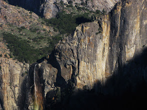 Photo: Rainbow'd Bridalveil Fall's top area w/ trees + looming shadow, from Tunnel