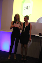 """Photo: Anna Lukanina, announcing the C4F award winner of """"Image of the Future"""""""