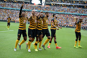 Daniel Cardoso of Kaizer Chiefs celebrates scoring a goal with teammates during the Absa Premiership match between Kaizer Chiefs and Orlando Pirates at FNB Stadium on November 09, 2019 in Johannesburg, South Africa.