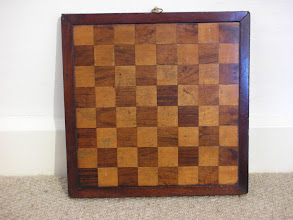 Photo: CH87; English board, mahogany and satinwood, 1.25in squares  Note the ring at the top, for wall etc hanging  This board looks really good with a set on it - far better than the above photo would indicate.