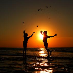 Happy Jump by Wahyu Jr. Abadi - Landscapes Sunsets & Sunrises ( gililabak, silhouette, sunset, geghans, beach, sunrise, landscape, light, sun, surabaya,  )
