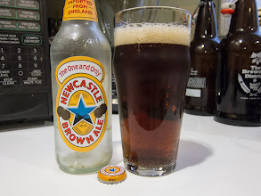 Photo: I picked up a six-pack of Newcastle Brown Ale at the grocery store on my way home from work. It's a basic, drinkable Brown Ale with some toffee and roasted malt flavors followed with a hint of hops at the end. Nothing special but nothing terrible either. What's with the clear bottle?