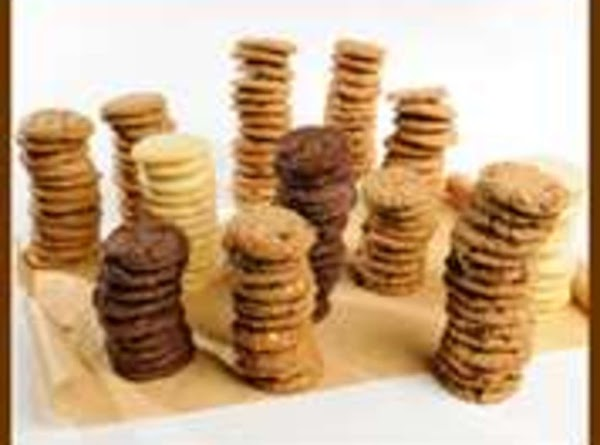 Slice each roll into 20 pieces. Dip tops into powdered sugar, then place in rows,...