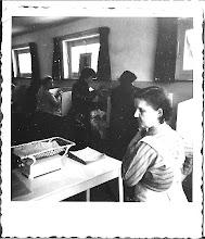 Photo: Tante Mien: zus van mijn vader, ze was een lief vrouwtje met een beperking. Op de foto staat ze in het Egmonds wijkgebouw, in de jaren 60. Zij assisteerde bij zuigenlingenzorg. Ze vond het geweldig!